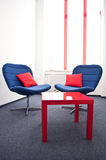 Meeting room. With blue chairs and red table in the modern office Royalty Free Stock Image