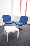 Meeting room. With blue chairs and white table in the modern office Stock Image