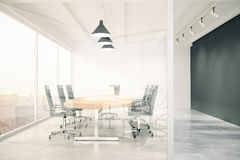 Meeting room with glass wall, blackboard, wooden table, window a Royalty Free Stock Photo