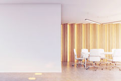 Meeting room with light wooden panels, toned Stock Photo