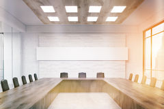 Meeting room with narrow horizontal poster Royalty Free Stock Image