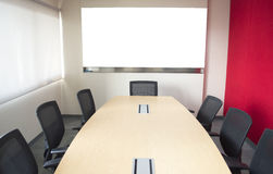 Meeting room with table chair and whiteboard. Meeting room with whiteboard table and chair Stock Photography