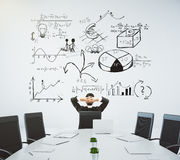 Meeting room with table and chairs and a business diagram on the Stock Images