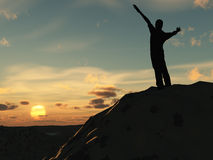 Meeting of the sun. The man on high mountain with the hands lifted above, on a background of a sunset Royalty Free Stock Photo