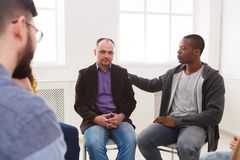 Meeting of support group, therapy session. Meeting of support group. Depressed men sitting at rehab group therapy. Psychotherapy, depression, life issues concept royalty free stock photos