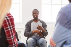 Meeting of support group, therapy session. Meeting of support group. African-american man talking about his life, telling his problems and issues. Mental health stock photos