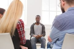 Meeting of support group, therapy session. Meeting of support group. African-american men talking about his life, telling his problems and issues. Mental health stock images