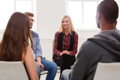 Meeting of support group, therapy session. Meeting of support group. Happy women talking about her life, everything good. Mental health, psychotherapy concept royalty free stock photo