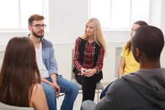Meeting of support group, therapy session. Meeting of support group. Young women therapist listening to other people. Mental health, psychotherapy concept stock image