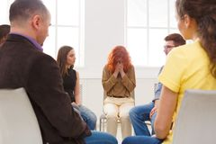 Meeting of support group, therapy session. Meeting of support group. Young despaired women crying during rehab group therapy. Psychotherapy, depression, life stock images