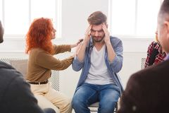 Meeting of support group, therapy session. Meeting of support group. Young depressed men with headache sitting at rehab group therapy. Psychotherapy, depression royalty free stock photos