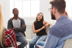 Meeting of support group, therapy session. Meeting of support group. Young women therapist listening to other people. Mental health, psychotherapy concept stock images