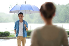 Meeting Sweetheart in Rain Stock Photo