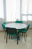 Meeting table. And 4 chairs near window Stock Photography
