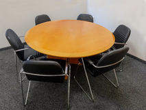 Meeting table and black chairs Stock Image