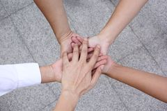 Meeting teamwork concept,Friendship,Group people with stack of hands showing unity on white background royalty free stock photos
