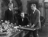 Meeting of three businessmen. (All persons depicted are no longer living and no estate exists. Supplier grants that there will be no model release issues Stock Images