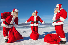 Meeting of three Santa Clauses Stock Photo