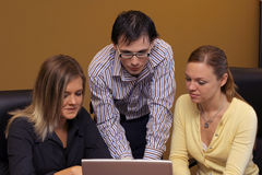 Meeting time 2. Groupd of young people at laptop Royalty Free Stock Photography