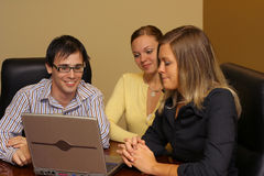 Meeting time. Group of young people at computer Royalty Free Stock Image
