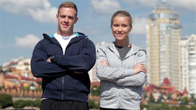 Meeting of two friends before training. In the city stock footage
