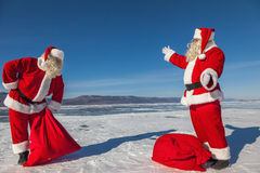 The meeting of two Santa Clauses royalty free stock photography