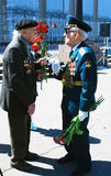 Meeting of two war veterans by the entrance to Gorky park. Stock Image