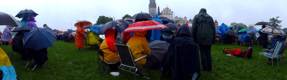 Meeting, vigil, prayer, worship in the pouring rain Royalty Free Stock Images