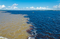 Meeting of waters. The Black River (Rio Negro) and Amazon River (Rio Amazonas) meet each other near Manaus City, the waters maintain separated for 8 kilometers Royalty Free Stock Images