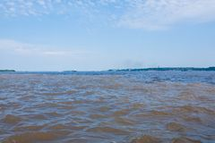 Meeting of Waters. Brazilian rivers confluence from Manaus Royalty Free Stock Photography
