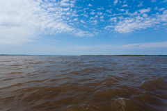 Meeting of Waters. Brazilian rivers confluence from Manaus Royalty Free Stock Images