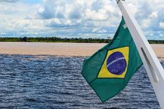 Meeting of the waters of Rio Negro and Amazon River with Brazil Stock Photos