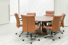 Meeting wooden table and brown chairs in meeting room Royalty Free Stock Photography