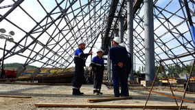 Meeting of workers under the dome of the object under construction.  stock footage