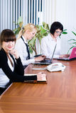 Meeting of young business ladies Royalty Free Stock Photos