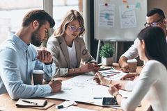 Daily meeting. Young modern people in smart casual wear working stock photo