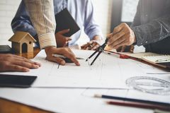 Meetings in home and property engineering companies of the group stock images