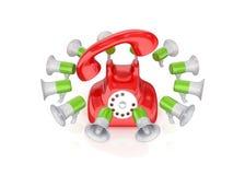 Megáfonos coloridos alrededor del teléfono retro. Foto de archivo