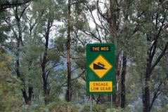 The Meg Sign Post. Warns drivers coming over Mount Hotham that the road is extremely dangerous and steep. Cars and trucks need to use low gear when travelling royalty free stock images