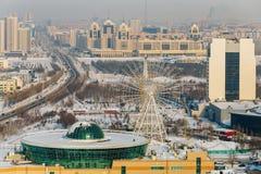 Mega Center Astana and the Ferris wheel on the left bank of Astana, Kazakhstan Stock Photos