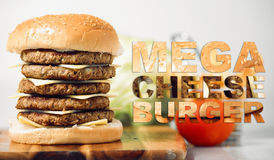 Mega Cheese Burger with typography. Mega cheeseburger with potato chips and ingredients on a white background with typography stock photo