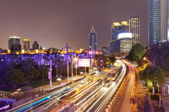 Mega city Shanghai. Shanghai/China: Megacity highway illuminated by lights motion blur from moving cars stock images
