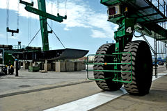 Mega crane with big driving wheels for building a mega yacht on a shipyard Stock Image