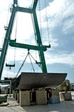 Mega crane for lifting metal pieces for the construction of a mega yacht at a shipyard Stock Images