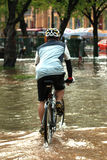 Mega flood in Bangkok. BANGKOK, THAILAND - OCTOBER 31 : unidentified People with bicycle in flood water in Bangkok after the heaviest rains in 50 years in Royalty Free Stock Photo