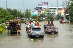 Mega flood in Thailand 2011. AYUTTHAYA, THAILAND - OCTOBER 9: Heavy flooding from monsoon rain in Ayutthaya and north Thailand arriving in Ayutthaya suburbs on Royalty Free Stock Image