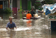 Mega flood in Thailand 2011. AYUTTHAYA, THAILAND - OCTOBER 9: Heavy flooding from monsoon rain in Ayutthaya and north Thailand arriving in Ayutthaya suburbs on Royalty Free Stock Photography