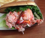 Mega lobster roll. Seafood lettuce roll Stock Photos