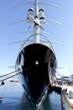 Mega luxury motor boat with sails Stock Photo