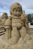 Mega man i sandskulpturfestival i Lappeenranta Royaltyfri Foto